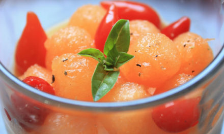 Panna cotta flavour goat cheese and basil, melon balls and pepper drops